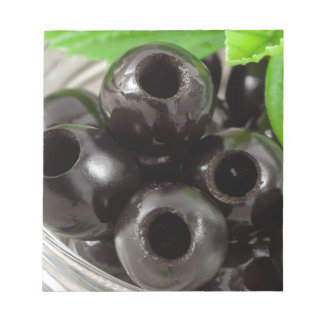 Detailed macro view of the black olives notepad