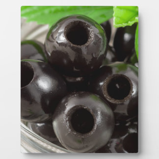 Detailed macro view of the black olives plaque