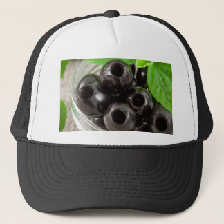 Detailed macro view of the black olives trucker hat