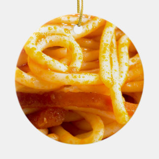 Detailed macro view on cooked spaghetti on a plate ceramic ornament