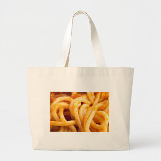 Detailed macro view on cooked spaghetti with sauce large tote bag