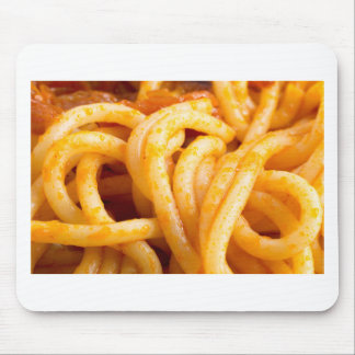 Detailed macro view on cooked spaghetti with sauce mouse pad