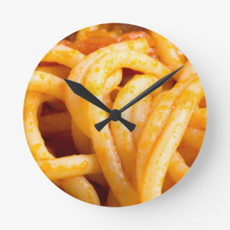 Detailed macro view on cooked spaghetti with sauce round clock