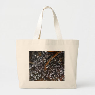 Dew drops in a spider net large tote bag