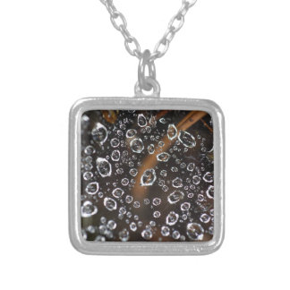 Dew drops in a spider net silver plated necklace