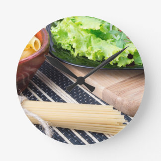 Diagonal composition on a table with a fresh salad round clock
