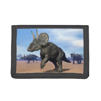 Diceratops/nedoceratops dinosaurs in the desert tri-fold wallets