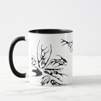Different fish swimming in the same direction mug