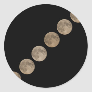 Different phases of rising full moon round sticker