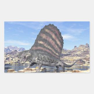 Dimetrodon standing in a pond in the desert rectangular sticker