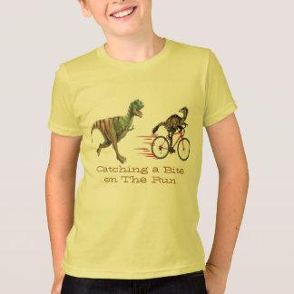 dinasaurs t-rex catching a bite on the run funny T-Shirt