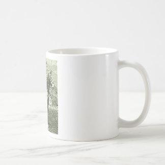 dinosaur man rides coffee mug