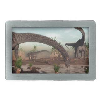 Diplodocus dinosaurs herd going to drink belt buckles