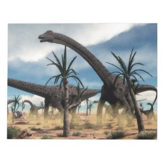 Diplodocus dinosaurs herd in the desert notepad