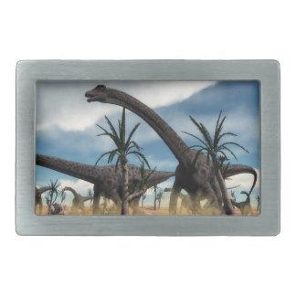 Diplodocus dinosaurs herd in the desert rectangular belt buckles