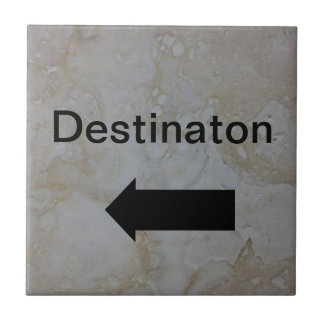 Directional arrow sign black on travertine photo ceramic tile