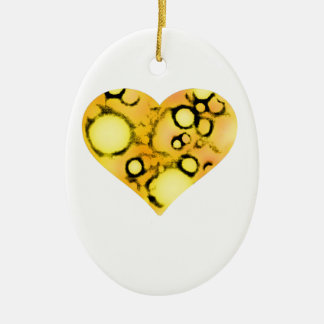 dirty yellow heart ceramic oval ornament