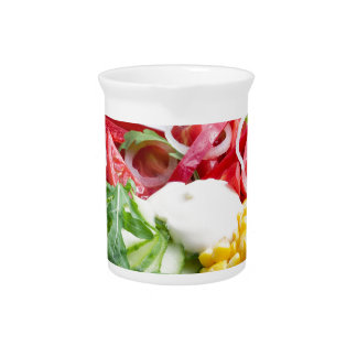 Dish from tomatoes, bell-pepper, mozzarella cheese pitcher