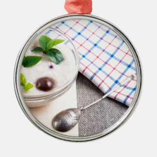Dish of oatmeal in a bowl of glass metal ornament
