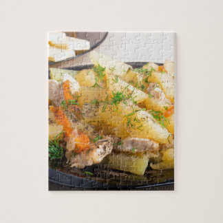 Dish of stewed potatoes with meat and spices jigsaw puzzle