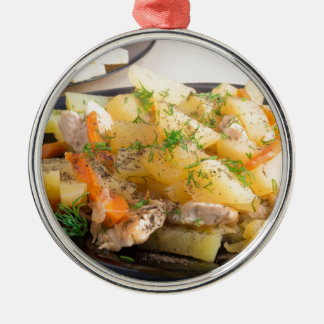 Dish of stewed potatoes with meat and spices metal ornament