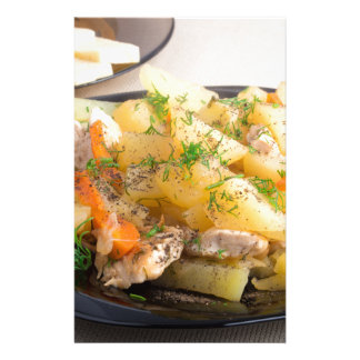 Dish of stewed potatoes with meat and spices stationery