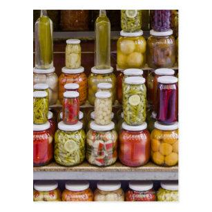 Display of pickled fruits and vegetables. postcard