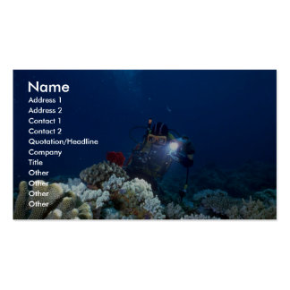 Diver shooting video on coral bed business cards