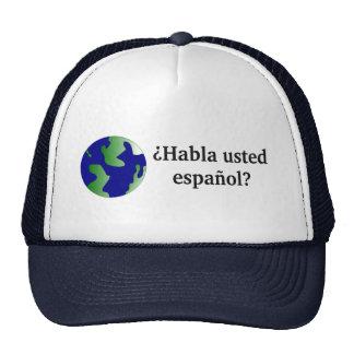 Do you speak Spanish? in Spanish. With globe Hats