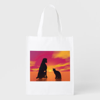 Dog and cat friendship at sunset reusable grocery bag