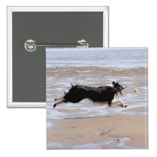 Dog chasing a ball at the beach 15 cm square badge