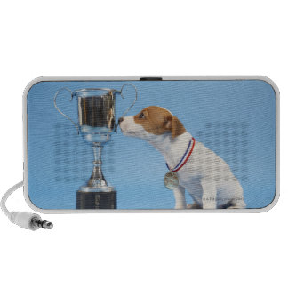 Dog with trophy travelling speakers
