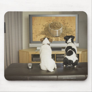Dogs watching dog dish with food on TV Mouse Pad