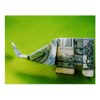 Dollar bill origami Elephant on Green background Postcard