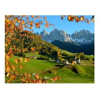 Dolomite village in autumn postcard