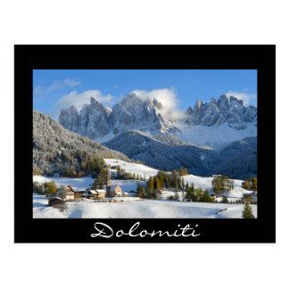 Dolomites village in winter black text postcard