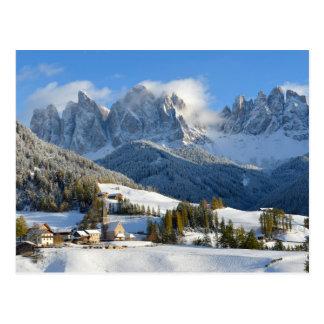 Dolomites village in winter postcard