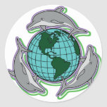 """Dolphins Circling Earth: """"Earth Day is Every Day"""" Classic Round Sticker"""