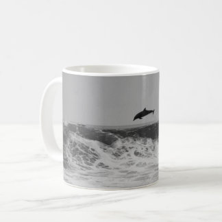 Dolphins jumping in waves Coffee Mug