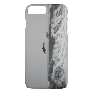 Dolphins jumping in waves Phone case