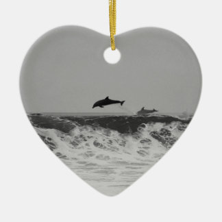 Dolphins jumping through waves in black & white ceramic heart decoration