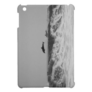 Dolphins jumping through waves in black & white iPad mini case