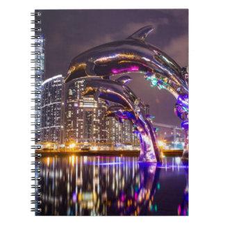 Dolphins on Urban Background Landscape Notebook