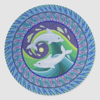 Dolphins playing in the waves classic round sticker