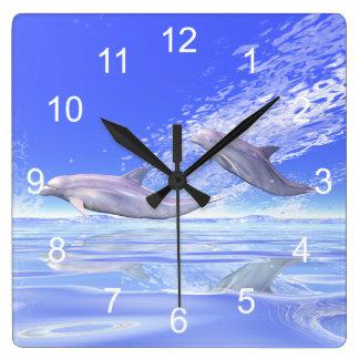 Dolphins Racing Clock