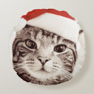 Domestic tabby cat wearing red Christmas hat Round Cushion