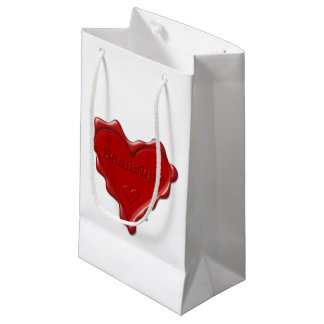 Dominique. Red heart wax seal with name Dominique. Small Gift Bag
