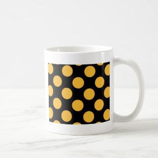 dotted black orange mugs