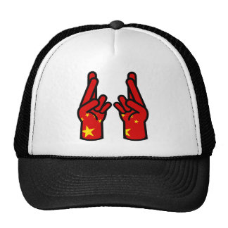 double crossed finger and wish good luck hat