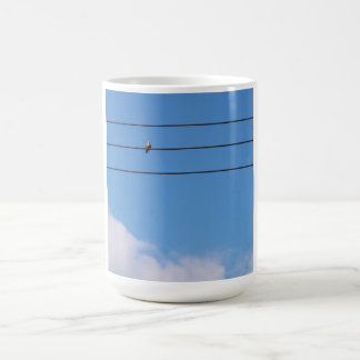 Dove on the wire coffee mug